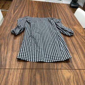 Black and white shoulder less dress.